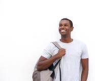 Pensamiento afroamericano sonriente del estudiante masculino Fotos de archivo libres de regalías