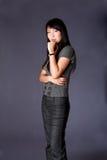 Pensamiento asiático de la mujer de negocios Imágenes de archivo libres de regalías