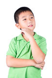Pensamiento asiático del muchacho aislado en el fondo blanco Foto de archivo libre de regalías