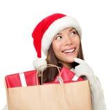 Pensamiento de la mujer de las compras de la Navidad Fotos de archivo libres de regalías