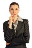 Pensamiento de la mujer de negocios. Aislado en blanco. Imagen de archivo