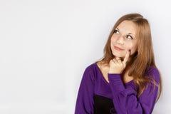 Pensamiento hermoso de la mujer joven Imagen de archivo libre de regalías