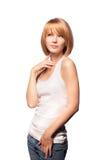 Pensamiento rubio lindo de la muchacha aislado en blanco. Fotos de archivo libres de regalías