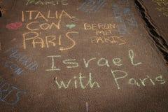 Pensamientos en una pared sobre el bombimg de París Foto de archivo libre de regalías