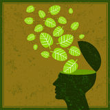 Pense as folhas da terra das economias do verde e o cérebro humano Foto de Stock