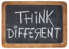 Pense diferente no quadro-negro Imagem de Stock