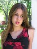 Penser de jeune femme Photographie stock libre de droits