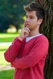 Penser de jeune homme Photographie stock libre de droits
