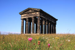 Penshaw Meadow. Penshaw Monument in Sunderland, Tyne & Wear, Northeast England.  A folly on a hill by the banks of the River Wear. Designed by John and Benjamin Royalty Free Stock Images