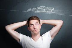 Pensi ad un'automobile Fotografie Stock