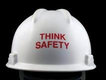Pensi il cappello duro di sicurezza fotografia stock