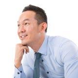 Pensiero asiatico dell'uomo Immagine Stock