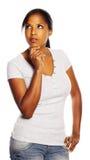 Pensiero della donna di colore Immagine Stock