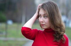 Pensiero della giovane donna Fotografie Stock