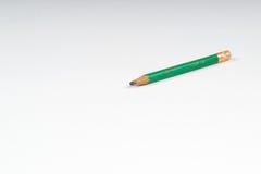 Pensil en el Libro Blanco De nuevo a escuela Fotografía de archivo libre de regalías