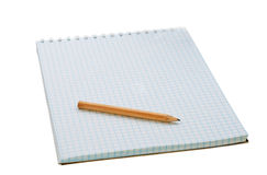 Pensil on the notebook. Isolated on white Royalty Free Stock Photography