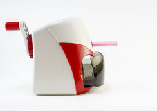 Pensil sharpener. A red pensil sharpener with pink color pensil isolated on white background Stock Images