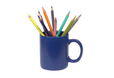 Pensils in blue cup  isolated on white. Nine pencils in the blue cup isolated on white Royalty Free Stock Photo