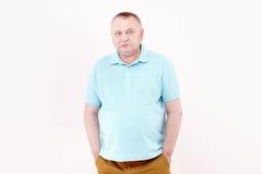 Pensionär med händer i fack Fotografering för Bildbyråer