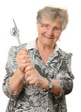 Pensionär med klubban Arkivbild