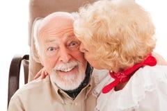 pensionären smår-hånglar Arkivbilder