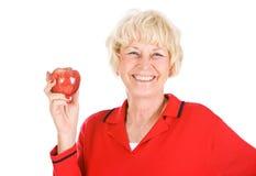Pensionärer: Hållande övre en Apple Arkivfoton
