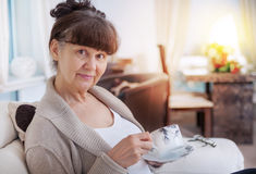 Pension age good looking woman with cup of tea Stock Image