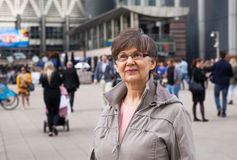 Pension age good looking woman portrait in the City. London Stock Photos