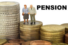 Pension. Figurine from senior couple with eruo coins on white background Royalty Free Stock Photos