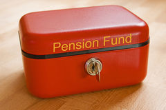Pension Fund. Red metal pension fund cash tin royalty free stock photography
