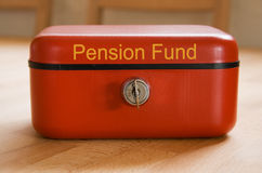 Pension Fund. Red metal pension fund savings tin Stock Image