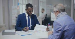 Pension fund black employee telling older man