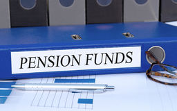 Pension Funds - blue binder in the office stock images