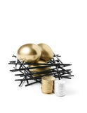 Pension Nest Egg. Concept image for pension planning Golden goose eggs in a stark wooden birds nest with stacked coins against a white background. Copy space Stock Photos