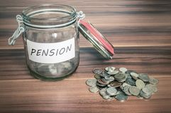 Pension savings in jar. Coins - pension savings in jar Royalty Free Stock Photography