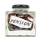 Pension. A small glass jar of coins isolated on a white background Stock Photography