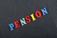 PENSION word on black board background composed from colorful abc alphabet block wooden letters, copy space for ad text Stock Image