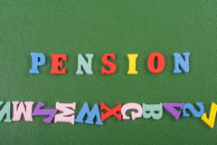 PENSION word on green background composed from colorful abc alphabet block wooden letters, copy space for ad text Stock Photo