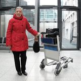 Pensioner. On the trip in the airport Royalty Free Stock Images