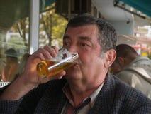 Pensioner/Beer Drinker. Older man is drinking beer Royalty Free Stock Image