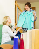 Pensioner bragging with new blouse Royalty Free Stock Photography
