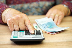 Pensioner is calculating how to split money for costs Stock Photo