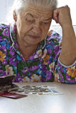 Pensioner counts money Stock Image