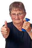 Pensioner does bodybuilding Stock Image