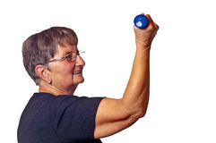 Pensioner does bodybuilding Stock Photos