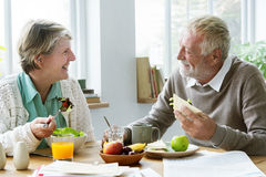 Pensioner Elderly Couple Eating Brunch Concept Stock Photos