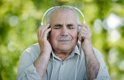 Pensioner enjoying his music Royalty Free Stock Photos