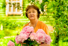 Pensioner with florets Royalty Free Stock Images