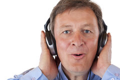 Pensioner with headphones singing to mp3 music Stock Photography