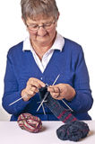 Pensioner knitting Royalty Free Stock Images
